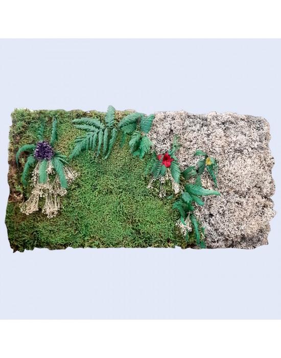 Jardín vertical con musgo, flores y seta preservados